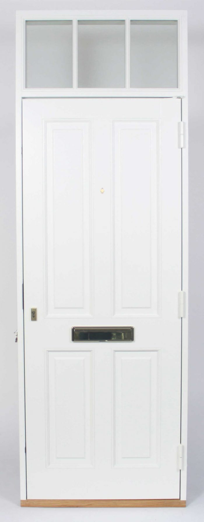 Gallery Image: External photo of panelled traditional front door with fixed fanlight above