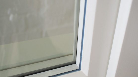 Gallery Image: Close up of warm edge spacer bar inside sash window