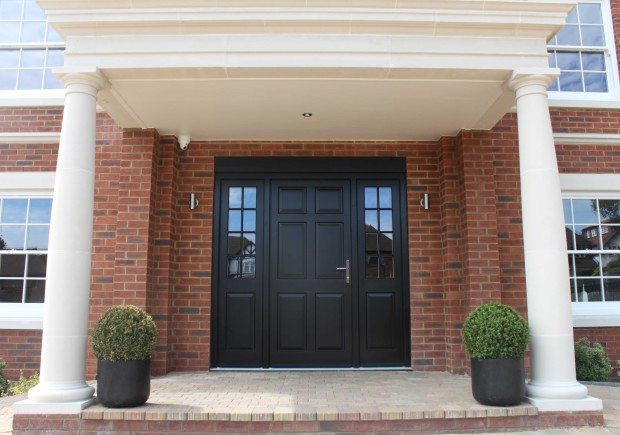 External view of panelled Front Door, including side lights with Georgian bars