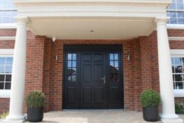 Gallery Image: External view of panelled Front Door, including side lights with Georgian bars. Traditional doors.