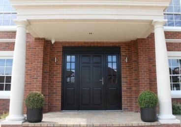 Gallery Image: External view of panelled Front Door, including side lights with Georgian bars. Traditional doors