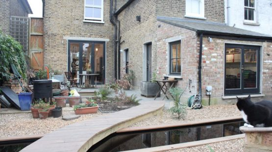Gallery Image: External rear facade of Forest Gate home, including sash windows, bi-fold doors and french doors.