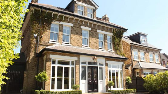 Gallery Image: Front facade of mansion in Potters Bar, including 2 over 2 sash windows, specially glazed front door, and fixed french doors