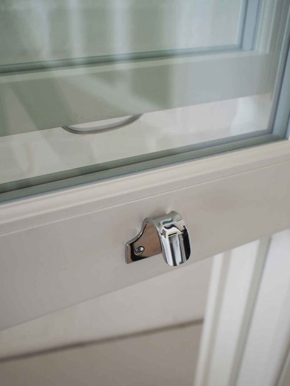 Gallery Image: Close up of polished chrome sash lift