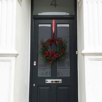 Gallery Image: External view of front door with timber panelling and satin glass