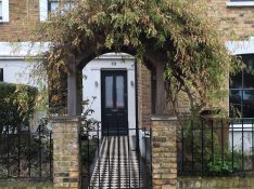 Gallery Image: Double Glazed Traditional Front Door Framed By Timber Arch