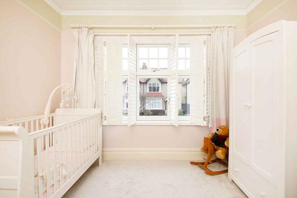 casement windows and shutters in bedroom