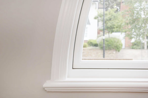 curved architrave and ornate sill