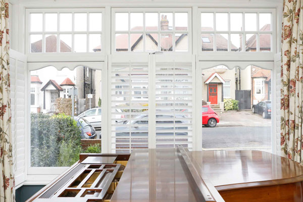 white casement windows bay with shutters in muswell hill n10