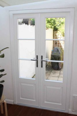 french-doors-with-timber-panels-and-two-glazing-bars