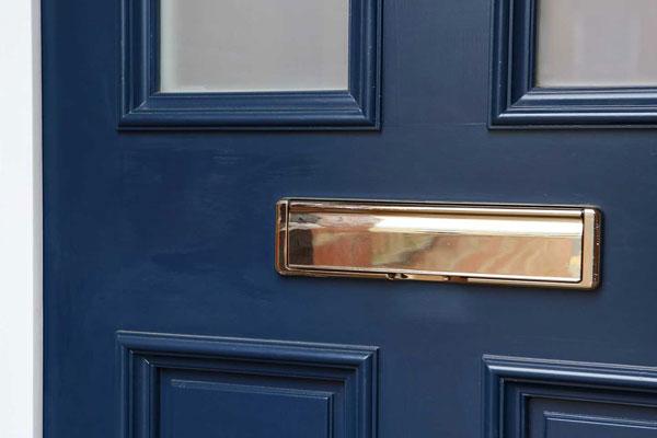 front-doors-blue-closeup-brass-letterbox