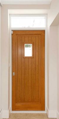 front doors timber finish with porthole