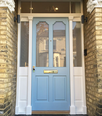 Front doors two timber two glass with fanlight