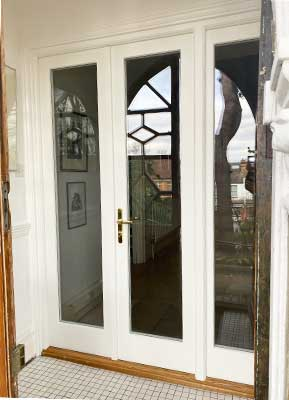 new french door in wood green exterior