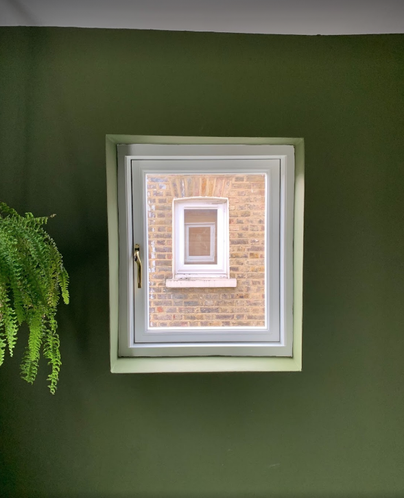Casement window with green wall paint