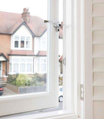 close up timber casement windows shutters