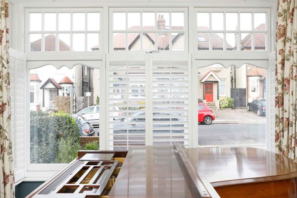 timber casement windows and piano