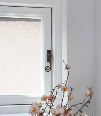 timber casement windows with monkey tail